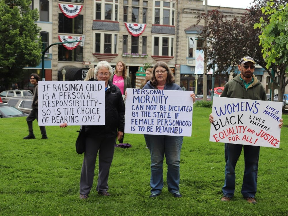 People stood outside around 12 p.m. on May 21 at the Monroe County Courthouse.Protesters brought signs with a variety of abortion-rights messages.