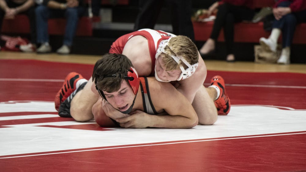 Freshman Cayden Rooks holds down Southern Illinois University Edwardsville redshirt sophomore Jacob Blaha on Feb. 16 in Wilkinson Hall. IU defeated SIUE 24-11.