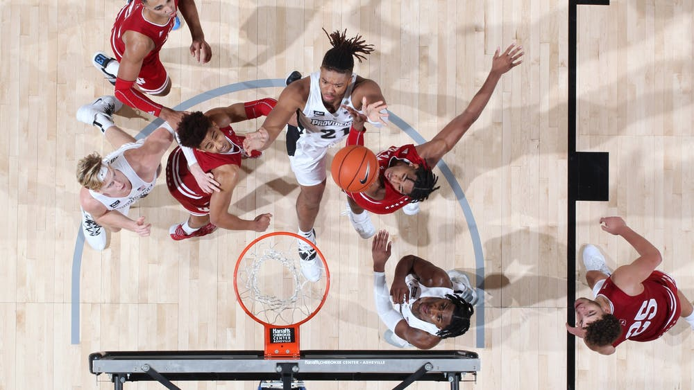 Players on the IU men's basketball team jump for a rebound over Providence players Nov. 30 in the first round of the Maui Invitational in Asheville, North Carolina. IU out-rebounded Providence 42-33 in the 79-58 victory on Monday.