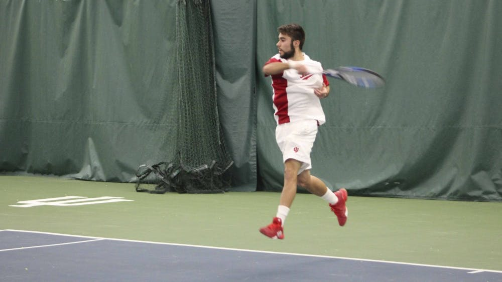Now-junior Antonio Cembellin returns a shot in his singles match against Princeton as a sophomore on Feb. 4, 2017. IU will travel to Tennessee this weekend to challenge the one-loss Middle Tennessee State Blue Raiders.