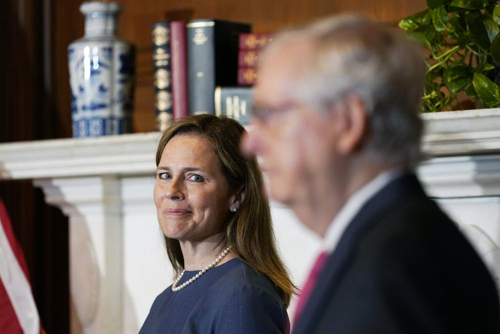 <p>Seventh U.S. Circuit Court Judge Amy Coney Barrett, left, President Donald Trump&#x27;s nominee for the U.S. Supreme Court, meets with Senate Majority Leader Mitch McConnell, R-KY, as she begins a series of meetings to prepare for her confirmation hearing Tuesday on Capitol Hill in Washington, D.C.</p>