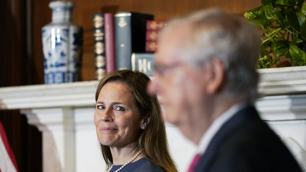 Seventh U.S. Circuit Court Judge Amy Coney Barrett, left, President Donald Trump's nominee for the U.S. Supreme Court, meets with Senate Majority Leader Mitch McConnell, R-KY, as she begins a series of meetings to prepare for her confirmation hearing Tuesday on Capitol Hill in Washington, D.C.