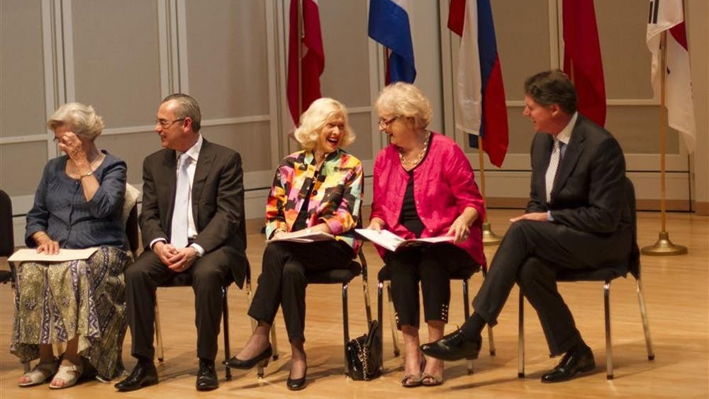 Susann McDonald, founder and artistic director of the USA International Harp Competition, center, talks with fellow members of the board of directors Wednesday at the Opening Ceremony for the 9th USA International Harp Competition. The competition will take place in the Jacobs School of Music July 10-20.