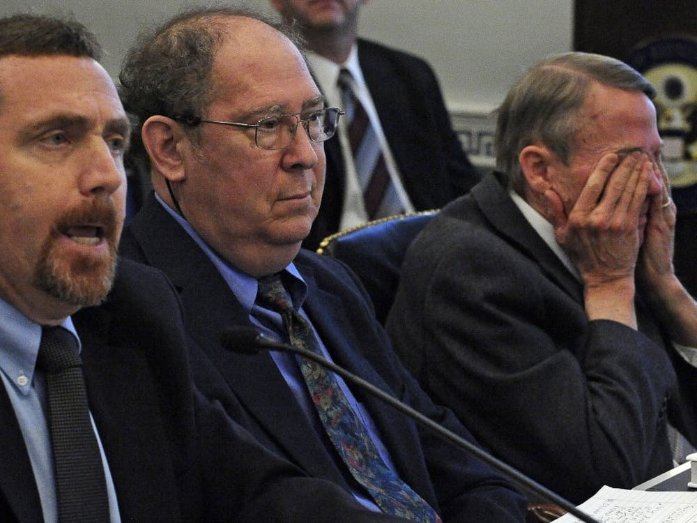 Ben Santer answers questions while Stephen Schneider and William Happer listen to testimony before the House Select Committee on May 20, 2010, on Energy Independence and Global Warming in Washington, D.C.