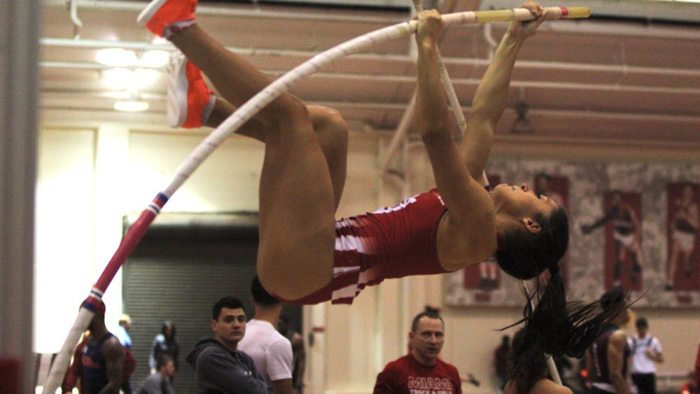 Sophomore Lauren Seaver participates in the pole vault competition during the IU Relays on Feb. 1 in Gladstein Fieldhouse. Seaver placed fifth in the event.