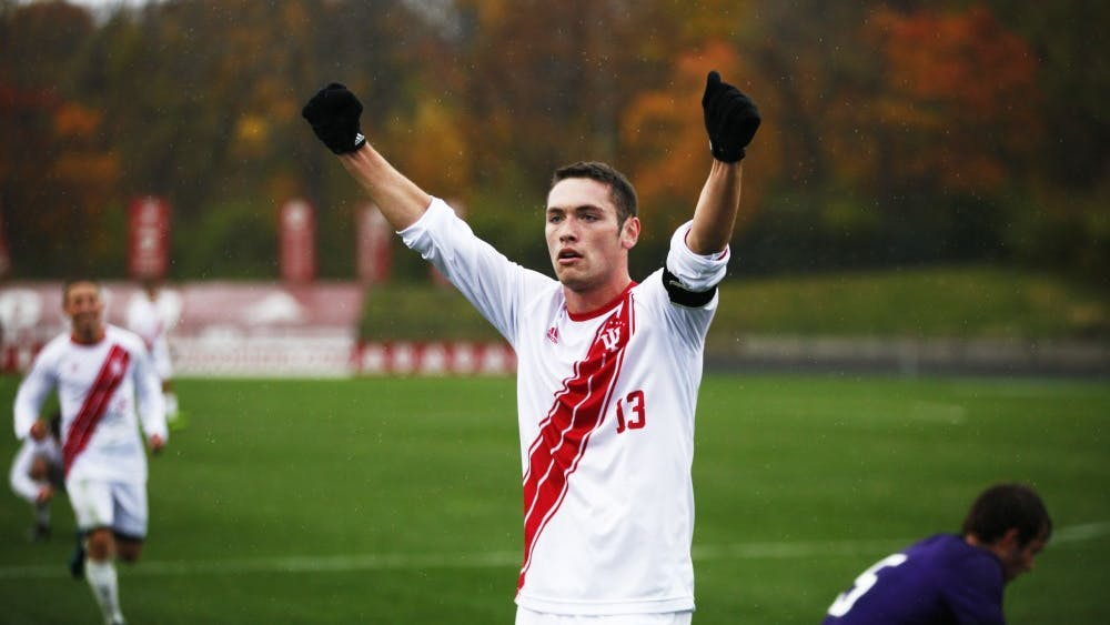 Senior Francesco Moore celebrates after IU scores the winning goal against Northwestern on Nov. 4 at Bill Armstrong Stadium. Moore assisted the final goal during overtime to finish the game with IU winning, 2-1.
