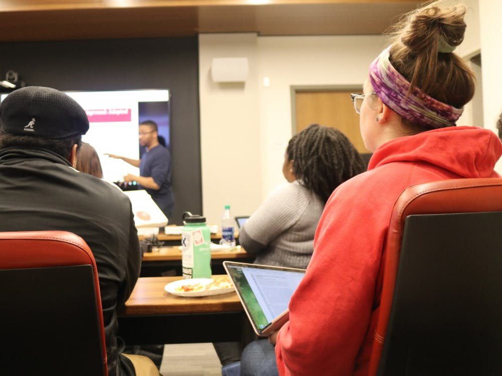 Students listen to Michael Jefferson, president of Students for Equity in Student Affairs, during a meeting Jan. 28 in the School of Public and Environmental Affairs. The meeting allowed students to give input on changes to Title IX.
