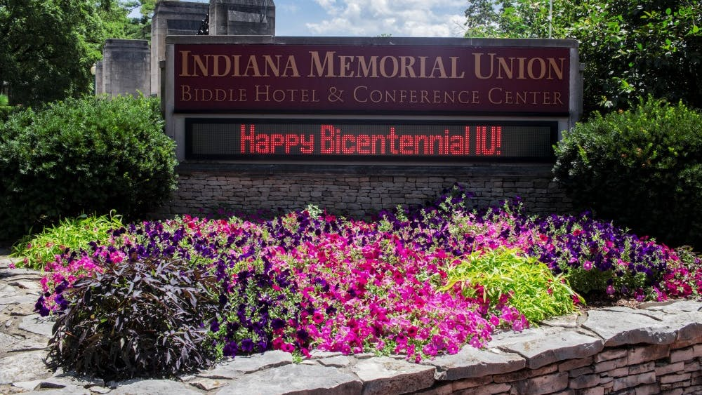 """A sign reads, """"Happy Bicentennial IU,"""" on July 11 in front of the Indiana Memorial Union. Comedy group Lewberger will give a free performance at 9 p.m. Nov. 1 in the IMU's Alumni Hall."""