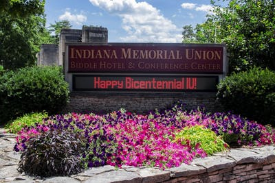 "A sign reads, ""Happy Bicentennial IU,"" on July 11 in front of the Indiana Memorial Union. Comedy group Lewberger will give a free performance at 9 p.m. Nov. 1 in the IMU's Alumni Hall."