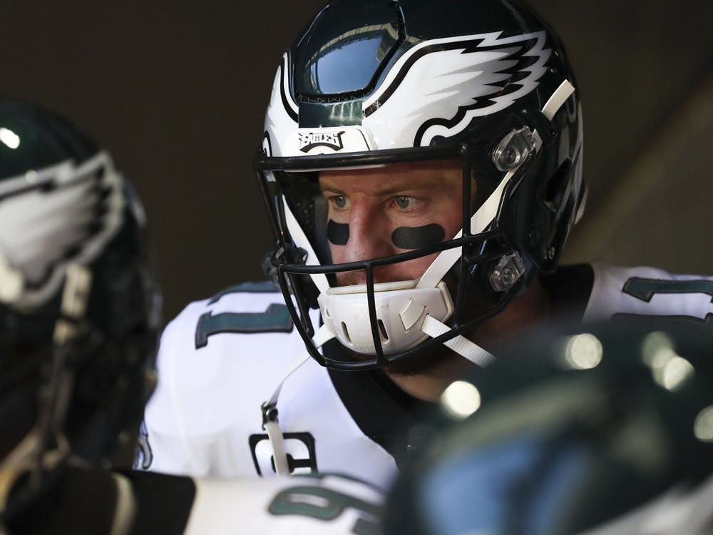 Then-Philadelphia Eagles quarterback Carson Wentz stands in the tunnel before a game Dec. 20, 2020, at State Farm Stadium in Glendale, Arizona. Wentz will play his first season with the Indianapolis Colts this year.