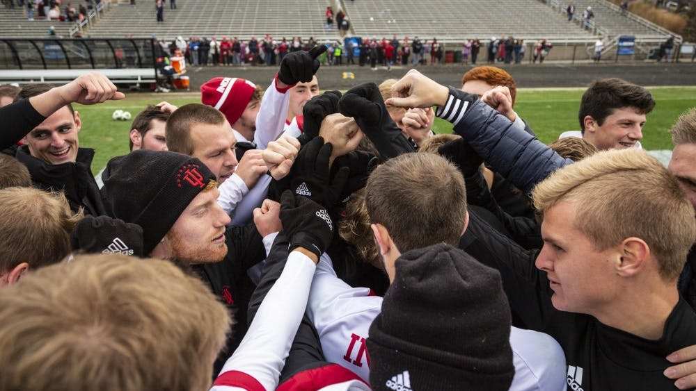 The IU men's soccer team joins hands after Coach Todd Yeagleys victory speech Nov. 18 at Bill Armstrong Stadium. IU defeated the University of Connecticut 4-0 in the second round of the NCAA Tournament. Senior defender Andrew Gutman tallied his 11th goal of the season in the 17th minute.