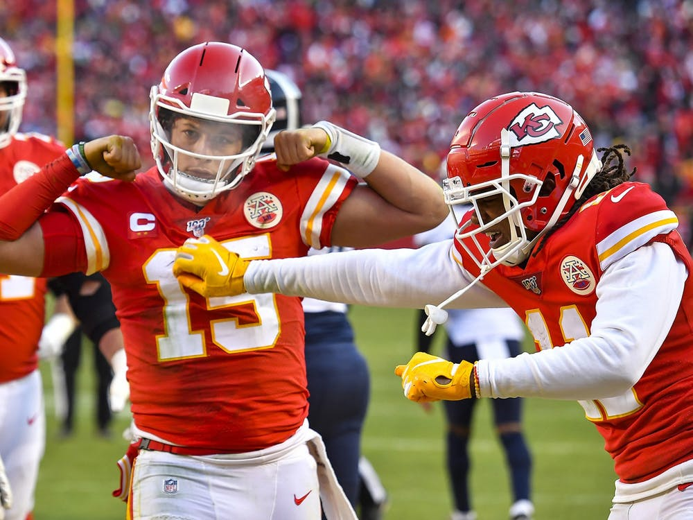 Kansas City Chiefs quarterback Patrick Mahomes celebrates his 27-yard touchdown run late in the second quarter against the Tennessee Titans during the AFC championship game  Jan. 19, 2020, at Arrowhead Stadium in Kansas City, Missouri.