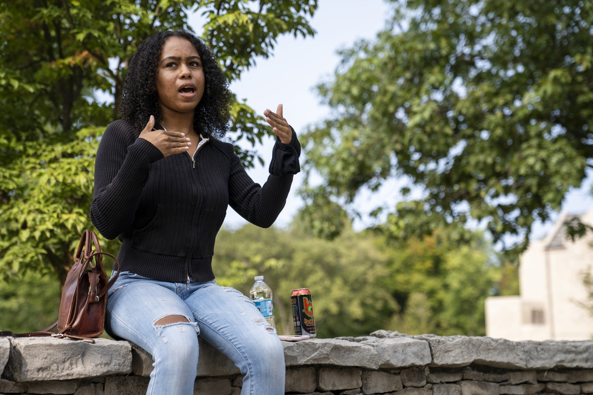 Aluko gestures to show how the incident happened. Around 60 other people were also at the bus stop when the man yelled at her, but none of them warned her or consoled her afterwards.