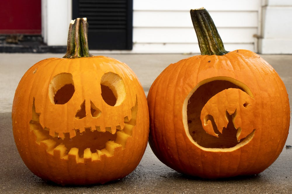 <p>Pumpkins carved by Air Force ROTC members sit Oct. 30 near the entry of the Military Science and Aerospace Studies building. Pumpkin-carving is a modern-day Halloween tradition.</p>