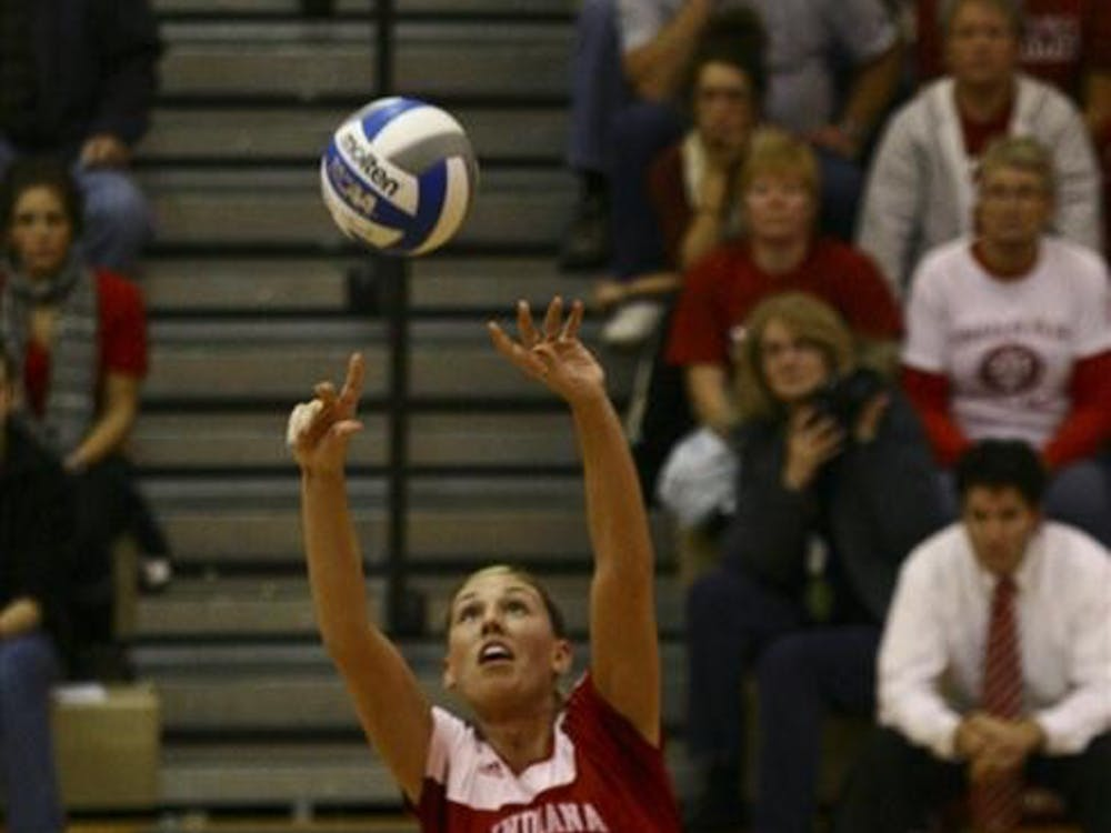 Junior Setter Mary Chaudoin sets the ball from the backcourt Saturday in University Gym. Chaudoin racked up 41 assists in the Hoosier's victory.