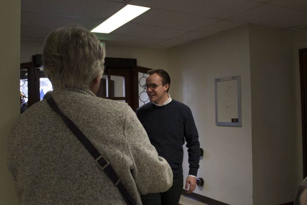 <p>Chasten Buttigieg, husband of Democratic presidential candidate Pete Buttigieg, shakes hands with attendees Dec. 6 in Woodburn Hall. Chasten Buttigieg came to talk to students and members of the public.</p>