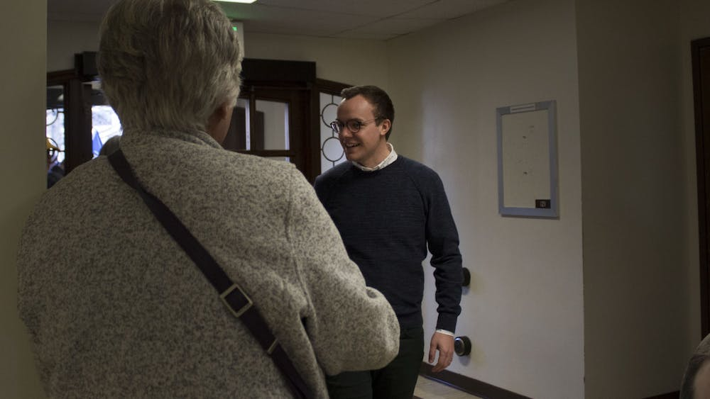 Chasten Buttigieg, husband of Democratic presidential candidate Pete Buttigieg, shakes hands with attendees Dec. 6 in Woodburn Hall. Chasten Buttigieg came to talk to students and members of the public.