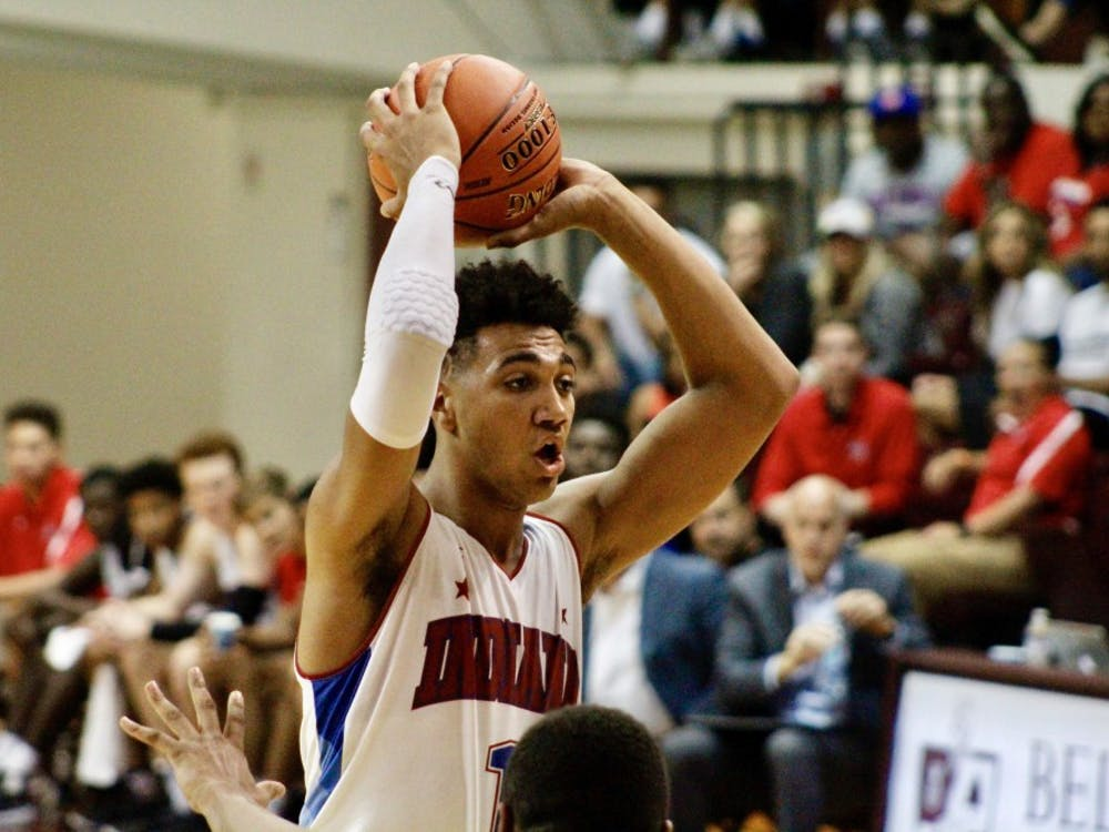 Incoming freshman Trayce Jackson-Davis looks to pass during the Indiana All-Stars' 97-64 victory over the Kentucky All-Stars June 7 at Bellarmine University.