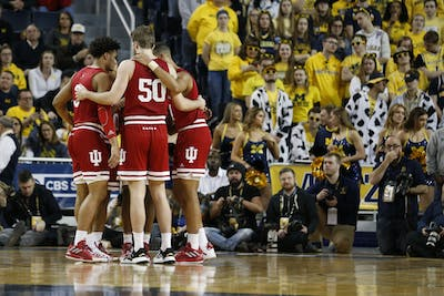 IU starters Aljami Durham, Joey Brunk, Rob Phinisee, Justin Smith and Trayce Jackson-Davis huddle  before the start of the game Feb. 16 against Michigan. IU defeated Minnesota 68-56 on Feb. 19 in Minneapolis, Minnesota.