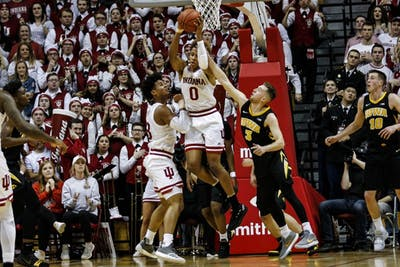 Freshman guard Romeo Langford rebounds the ball against Iowa on Feb. 7 at Simon Skjodt Assembly Hall. IU was down at halftime, 46-36.