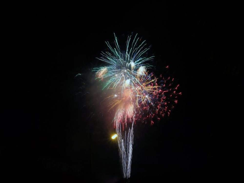 Fireworks are set off from the Trades District July 3, 2018, in downtown Bloomington. The city will be having its annual Fourth of July parade Thursday.