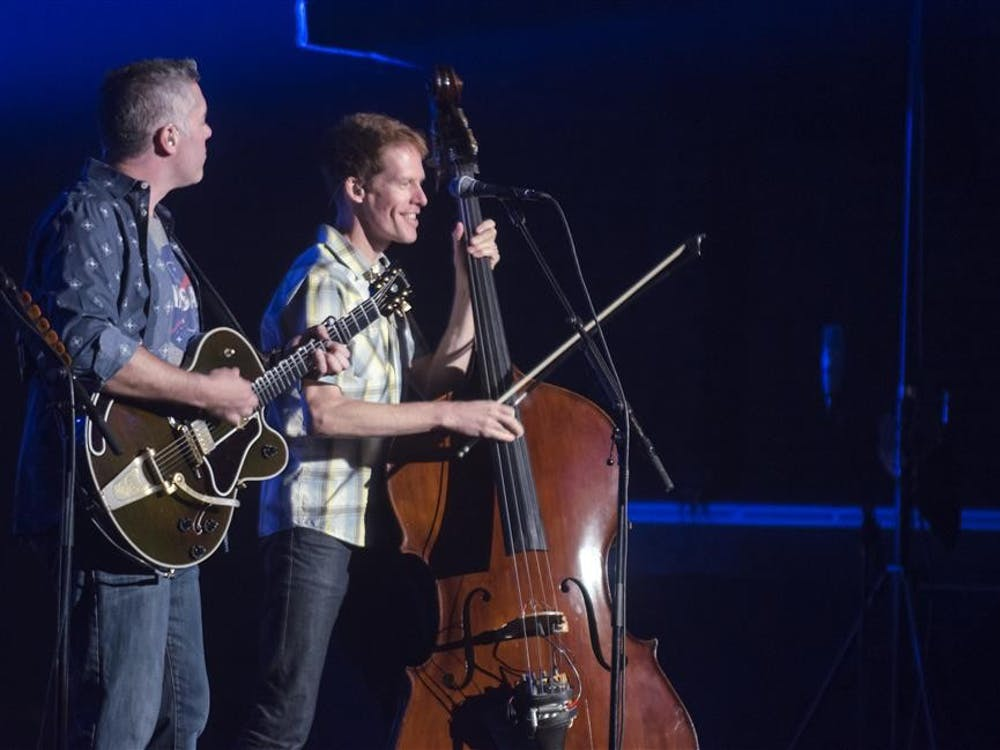 Bassist Jim Creeggan and lead singer Ed Robertson perform during the Barenaked Ladies concert Tuesday at the IU Auditorium.
