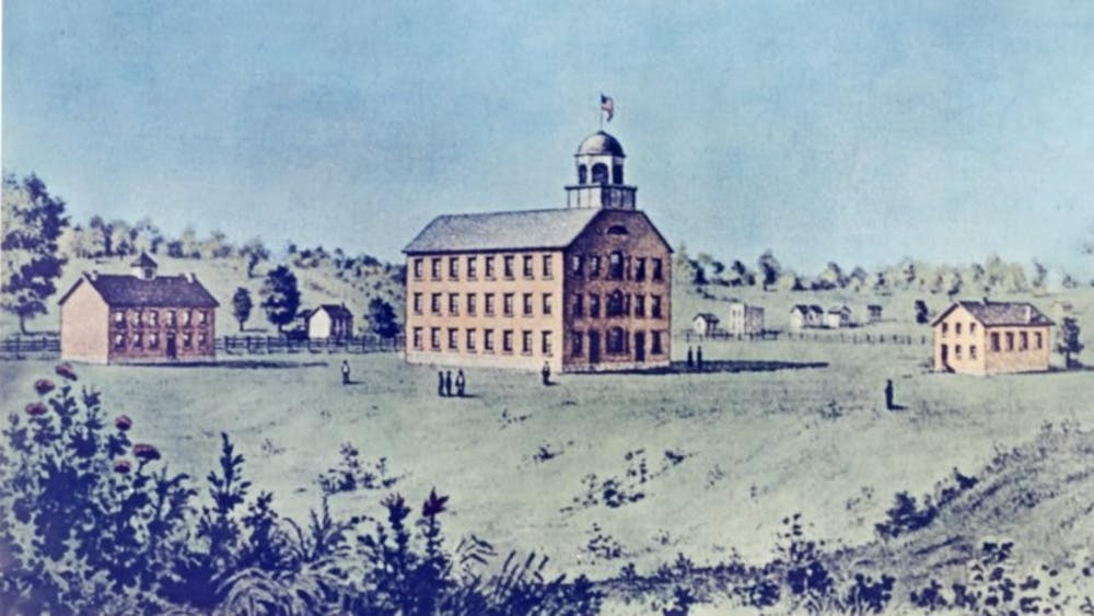 Three of the five buildings on IU's first campus were photo printed around 1850. The Seminary Building was the campus' first classroom building, and it was built in 1825.