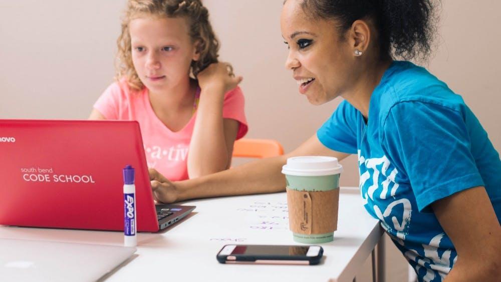 Teacher Alexandra Sejdinaj instructs a student at South Bend Code School.