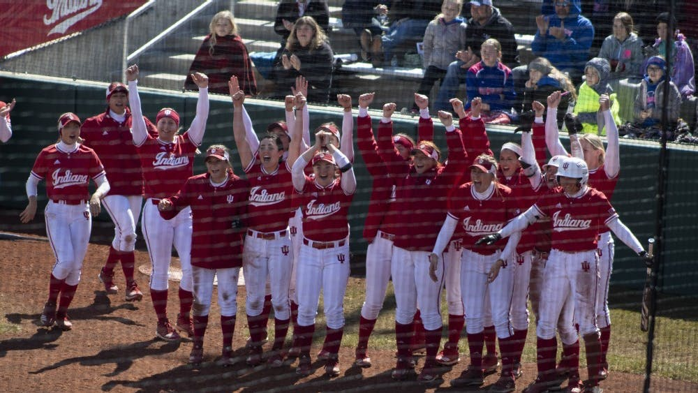 The IU softball team cheers on then-sophomore Grayson Radcliffe on March 17, 2019, after she hit a grand slam against Saint Francis University. The Hoosiers scored two wins against Wisconsin on Saturday, as well as a win and a loss against Minnesota on Sunday.