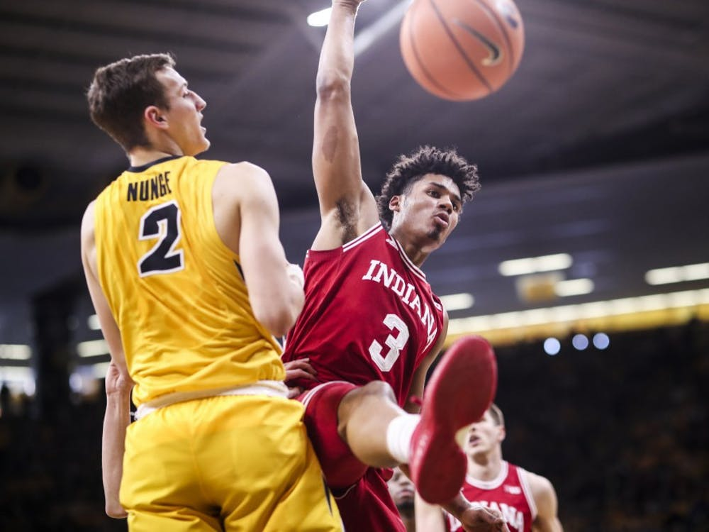 Then-freshman forward Justin Smith follows through after dunking the ball against Iowa on Feb. 17, 2018, at Carver-Hawkeye Arena in Iowa City, Iowa. The Hoosiers beat the Hawkeyes, 84-82.