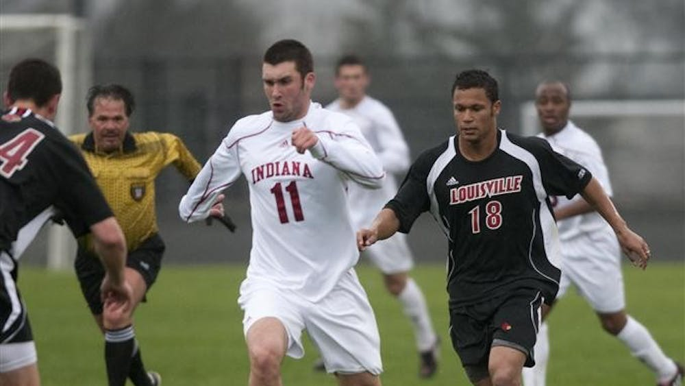 Sophomore forward Will Bruin dribbles the ball downfield in IU's 2-1 win against Louisville on Sunday.