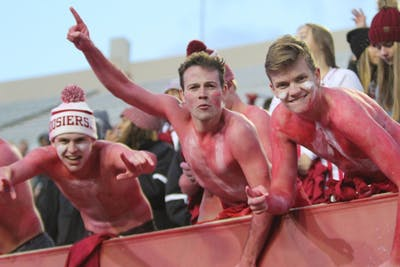 Shirtless IU fans in the student section show their support before the game begins Nov. 2 at Memorial Stadium. IU won against Northwestern 34-3.