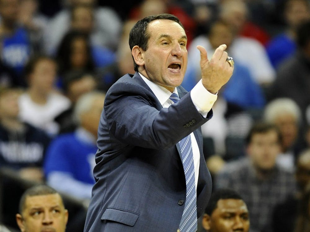 Duke head coach Mike Krzyzewski talks to his players while taking on Robert Morris during the first half in the second round of the NCAA Tournament at Time Warner Cable Arena in Charlotte, N.C., on Friday, March 20, 2015. (David T. Foster, III/Charlotte Observer/TNS)