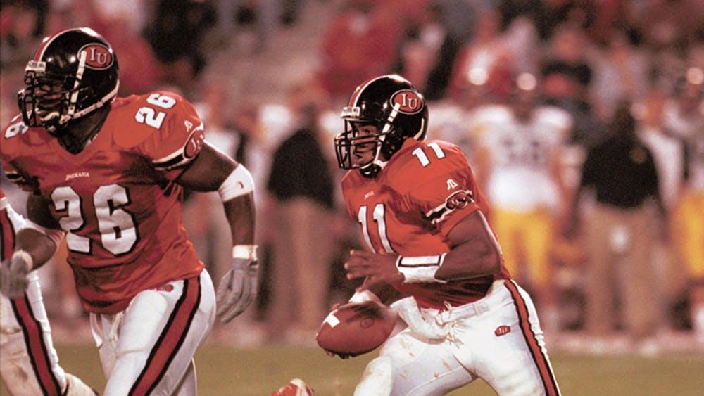 Former IU quarterback Antwaan Randle El begins the option with DeWayne Hogan at his side during the Hoosiers' 2000 victory against the Iowa Hawkeyes at Memorial Stadium. Randle El won a Super Bowl in 2006 with the Pittsburgh Steelers.