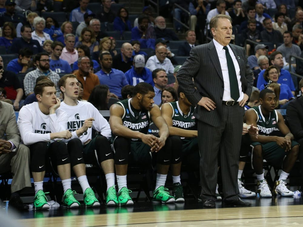 Michigan State assistant coach Dane Fife sits on the sideline during a game. Fife will join IU men's basketball head coach Mike Woodson's staff, the program announced Monday.