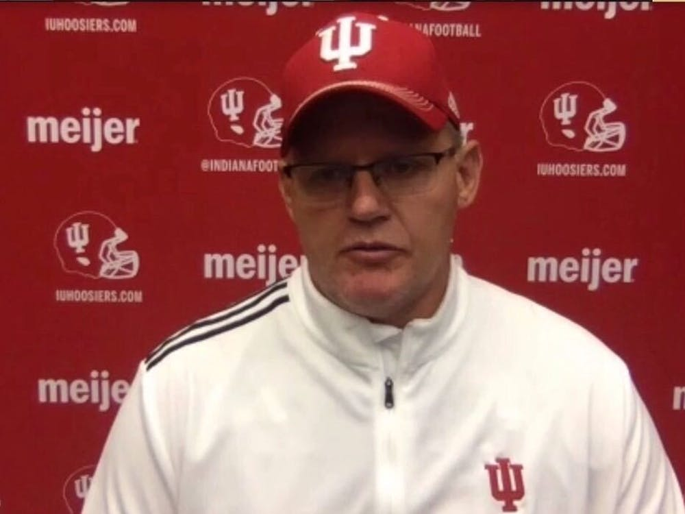A screenshot shows IU head football coach Tom Allen speaking Monday at a virtual press conference.
