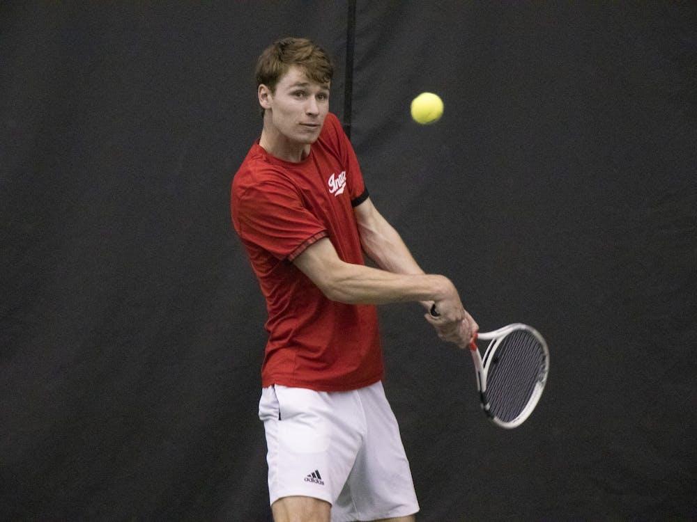 IU senior Bennett Crane returns the ball in a match against Purdue University on Feb. 22, 2020, at Schwartz Tennis Center. Big Ten play begins for IU men's tennis this weekend