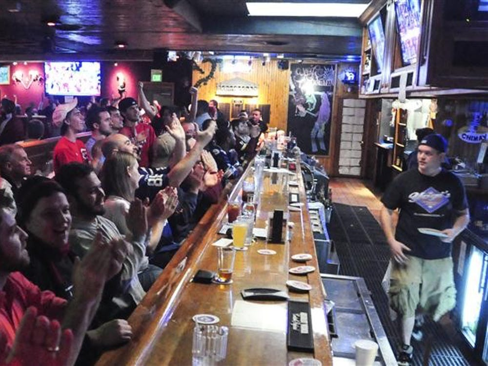 Fans at Yogi's Bar and Grill celebrate the Hoosiers' victory against Georgetown in the NCAA Soccer Championship.