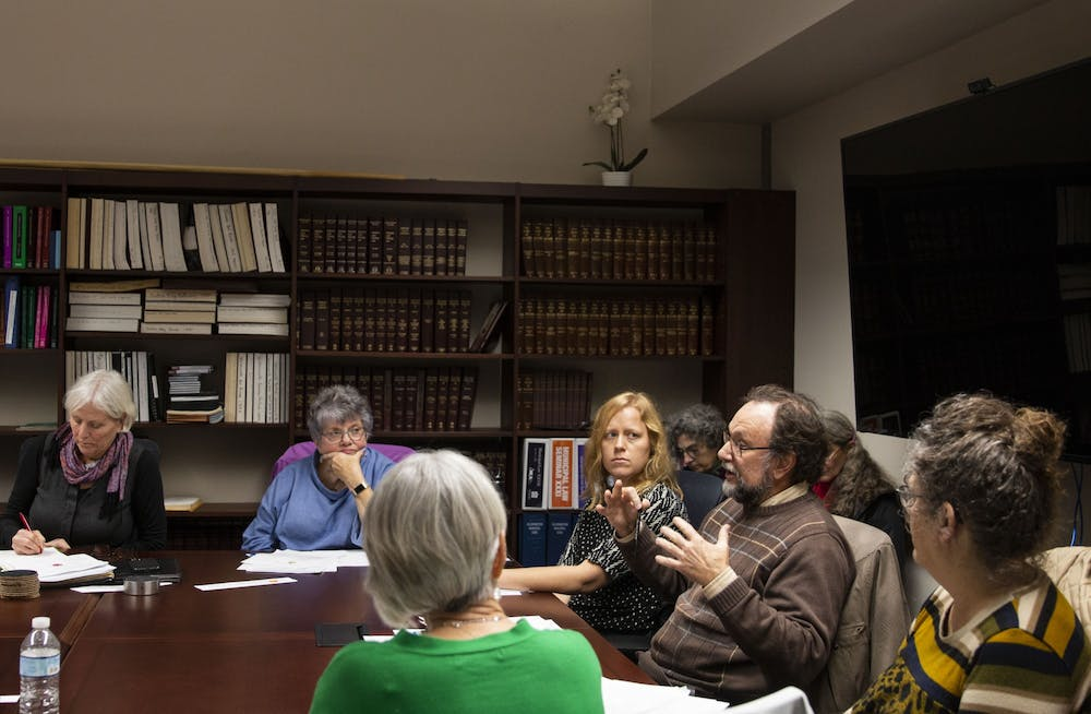 <p>Members of the Farmers' Market Advisory Council discuss the future of the Bloomington Community Farmers' Market on Dec. 9 in City Hall. Members of the community, vendors and members of the Purple Shirt Brigade were in attendance at the meeting. </p>