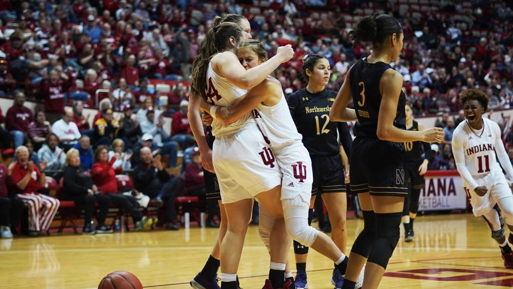 Redshirt junior Ali Patberg hugs freshman Mackenzie Holmes Jan. 16 in Simon Skjodt Assembly Hall. Holmes was fouled near the end of the 4th quarter, filling the stadium with excitement for the possibility of a further lead during a close game where IU lost 71-69 in overtime.