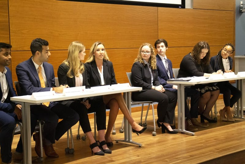 Vision for IUSG candidates listen to Mackenzie North, the presidential candidate for Bridge IU, during the IU Student Government town hall on March 19 in the Global and International Studies Building. Students were able to ask and submit questions, ranging from gun violence to greek life, for the two tickets to answer.