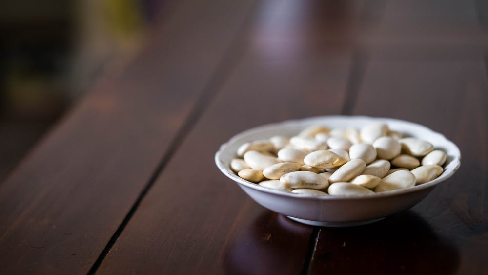 A bowl of Corona beans are left out on a table Sept. 14. Corona beans are large white beans that are members of the runner family.
