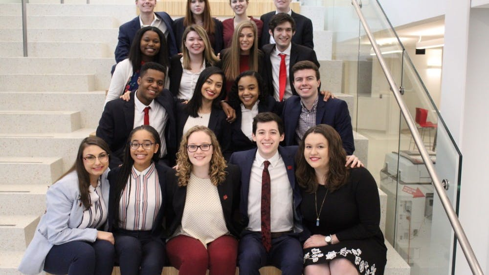 Members of the Vision ticket for IU Student Government sit together for a photo in Luddy Hall. The IUSG Election Commission confirmed Vision received the most votes in this year's election.