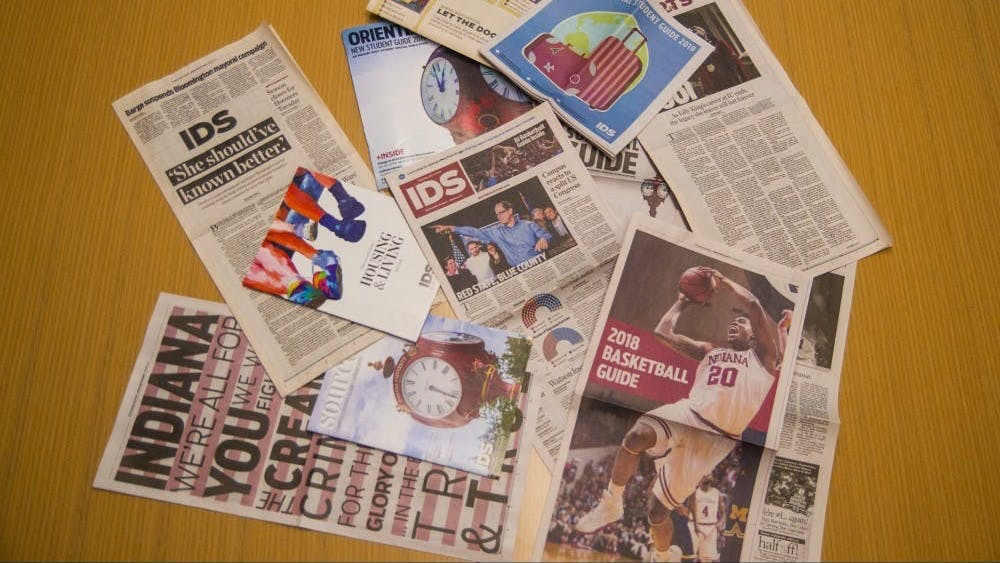 A collection of Indiana Daily Student publications lay on a table. The IDS took home a Hybrid News Gold Crown from the Columbia Scholastic Press Association.
