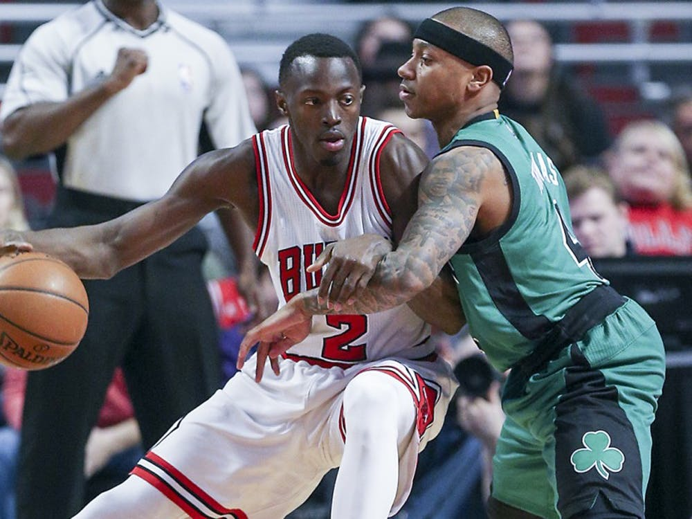 The Boston Celtics Isaiah Thomas, right, defends against the Chicago Bulls Jerian Grant during the first half at the United Center in Chicago on Thursday, Feb. 16. The Bulls won, 104-103.