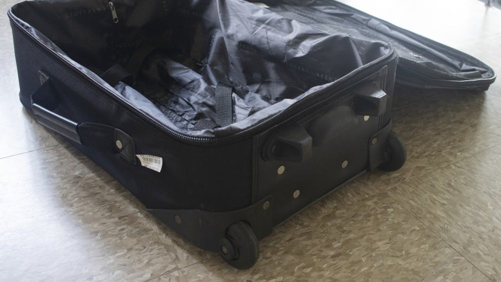A suitcase sits open on the ground May 17 in University East Apartments.