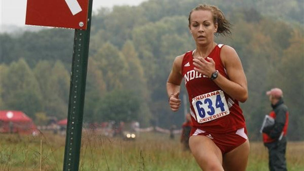 Sophomore Sarah Pease takes a turn Saturday at the Indiana Open at the IU cross country course. Pease finished first in the 5k race with a time of 18:12.86.