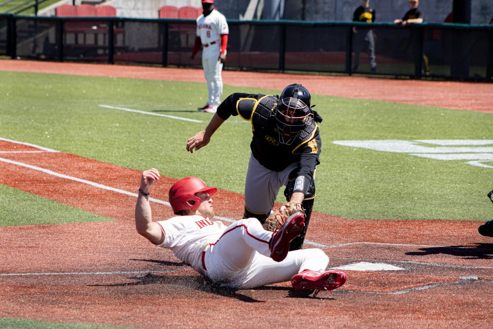 <p>Sophomore outfielder Tyler Van Pelt slides into home plate Saturday at Bart Kaufman Field. The Hoosiers went 2-1 this weekend against Iowa at home. </p>