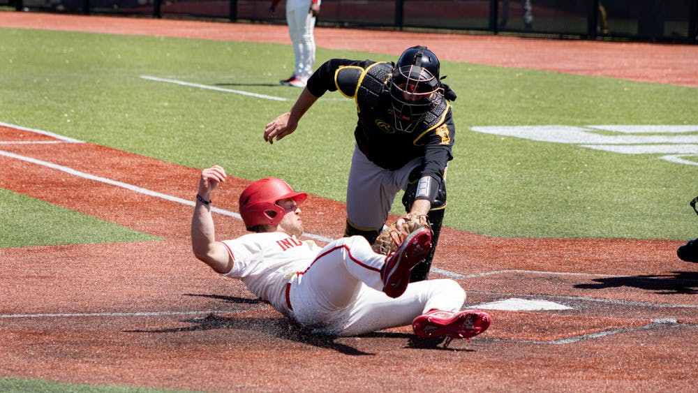 Sophomore outfielder Tyler Van Pelt slides into home plate Saturday at Bart Kaufman Field. The Hoosiers went 2-1 this weekend against Iowa at home.