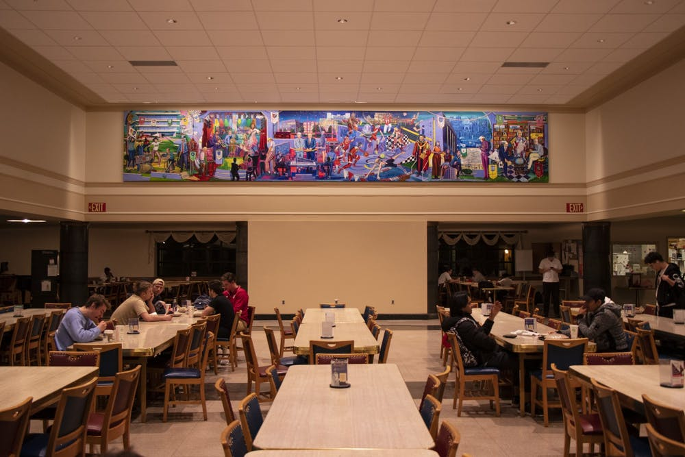 <p>A mural celebrating IU's history is on display Feb. 4 at Wright Quad dining hall. The mural depicts the history of IU from 1998 to 2020.</p>